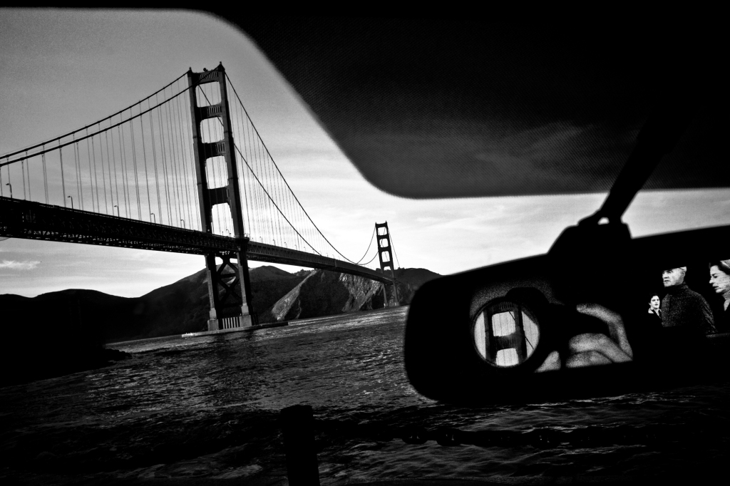Driver Photographs Golden Gate Bridge and Reflection